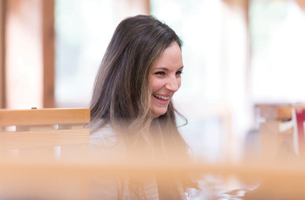 woman laughing after her IT company helped with managed detection and response